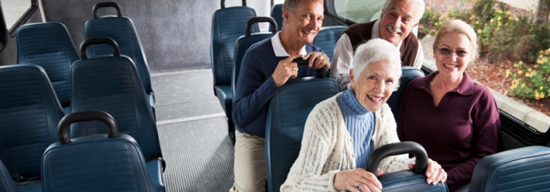 Seniors in shuttle bus